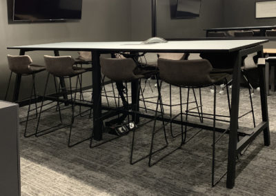 bar stools and desk in an open meeting space