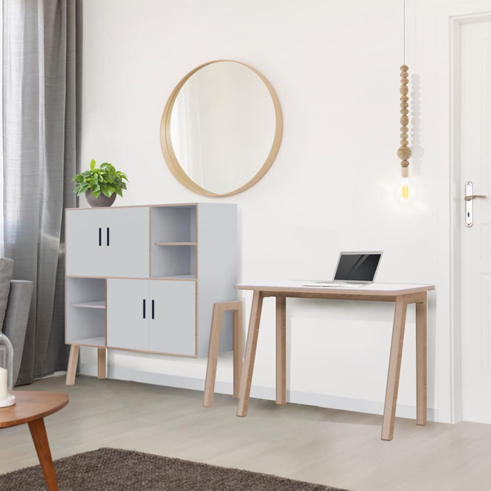 Home office working space with a white cupboard and a white table for Ukhuni