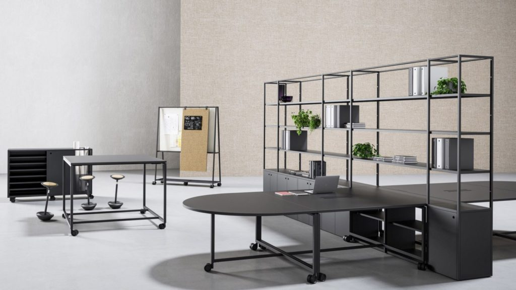 Open office work space with modular furniture and a stand with shelves interior design for Ukhuni