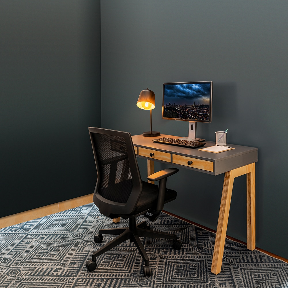 Home office working space with a table and chair for Ukhuni