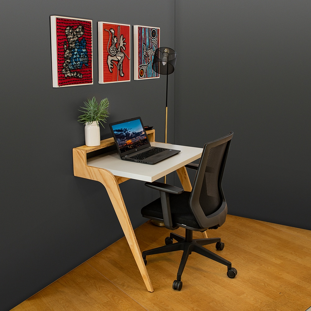 Home office working space with a white table and a cha